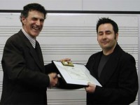 Dr. Allan Zavod presenting the 2003 inaugural award to Andrian Pertout - click to see an enlarged version of this image