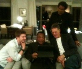 Allan Zavod and son Zak visiting with George Benson in Hotel room - click to see an enlarged version of this image