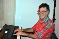 Dr. Allan Zavod on Keyboard at Cafe Latte Dec 2013 - click to see an enlarged version of this image