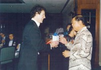 Allan Zavod presenting a gift to the Secretary General of Malaysia - click to see an enlarged version of this image